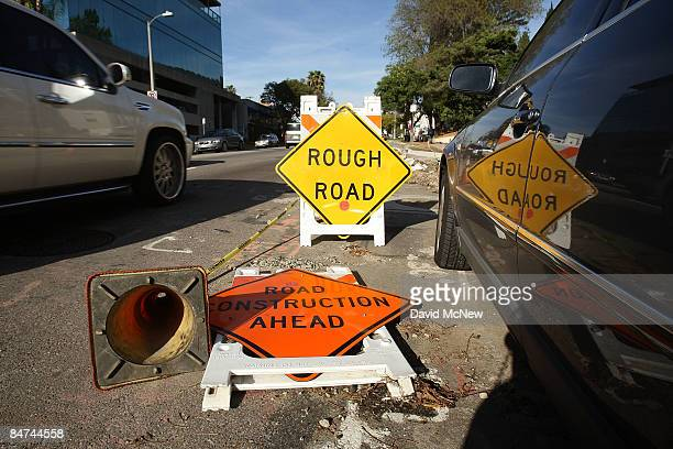 Traffic travels a damaged street on February 10 2009 in Los Angeles California Failure of the Legislature to pass a state budget led to the...