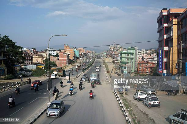 Traffic travels along an earthquakedamaged road in Kathmandu Nepal on Wednesday June 3 2015 Nepal's gross domestic product will probably grow 38% in...