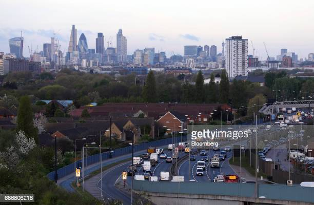 Traffic travels along the A13 dual carriageway as the City of London financial district stands on the skyline beyond in London UK on Monday April 10...