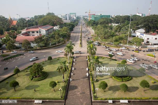 Traffic travels around the park at the Patuxai Victory monument in Vientiane Laos on Thursday Nov 2 2017 Located in the Mekong region Southeast...