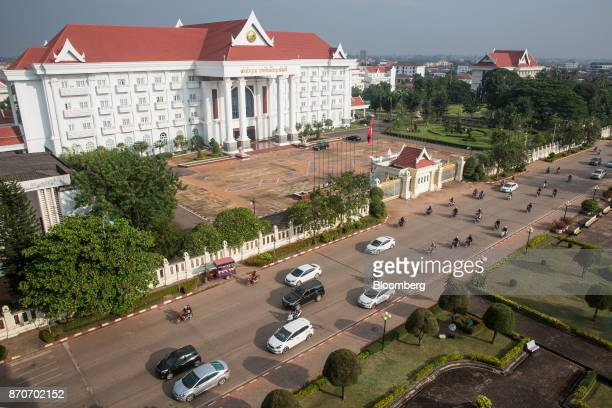 Traffic travels past the Prime Minister's office building in Vientiane Laos on Thursday Nov 2 2017 Located in the Mekong region Southeast Asia's...