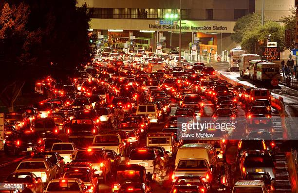 Traffic waits for hours to cross into the US at the worlds busiest border crossing December 10 2001 in the border city of Tijuana Baja California...