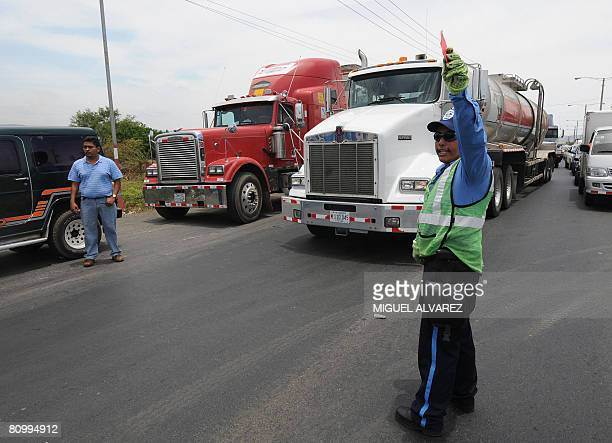 A traffic warden controls the Panamericana highway during a protest against the high prices of oil on May 5 2008 in Ciudad Sandino some 12 km from...