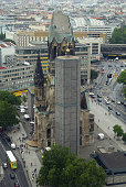 Traffic zips by the landmark Kaiser Wilhelm Memorial Church on August 18 2008 in Berlin Germany The church damaged in World War II and left in its...