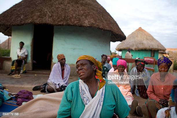 A tragic early morning scene in the Makuleke Village a mourners wails in the early morning after and allnight prayer vigil at the home of a young...