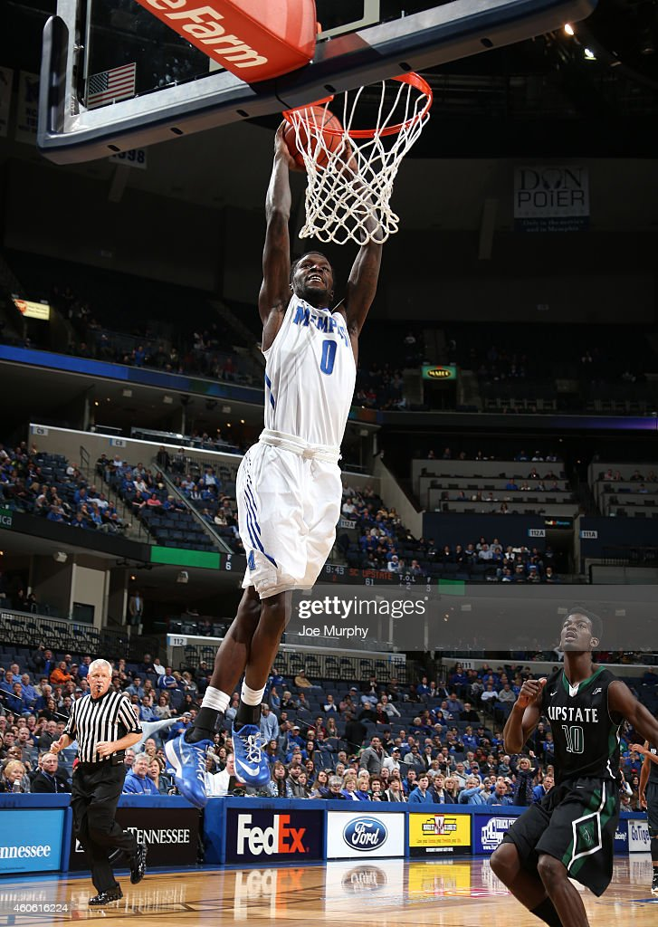 Trahson Burrell of the Memphis Tigers dunks the ball against the USC Upstate Spartans on December 17 2014 at FedExForum in Memphis Tennessee Memphis...