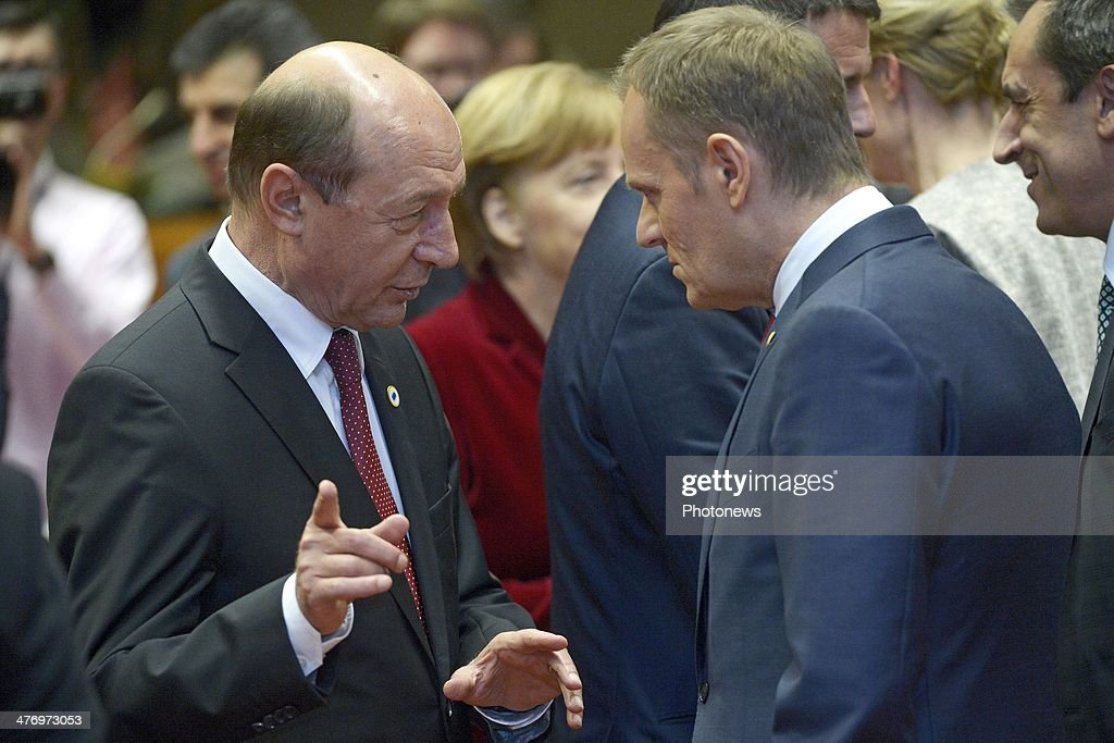 <a gi-track='captionPersonalityLinkClicked' href=/galleries/search?phrase=Traian+Basescu&family=editorial&specificpeople=542324 ng-click='$event.stopPropagation()'>Traian Basescu</a>, President of Romania and <a gi-track='captionPersonalityLinkClicked' href=/galleries/search?phrase=Donald+Tusk&family=editorial&specificpeople=870281 ng-click='$event.stopPropagation()'>Donald Tusk</a>, Prime Minister of Poland speak during a meeting to discuss the situation in Ukraine at the European Union Council Building on March 6, 2014 in Brussels, Belgium. The EU leaders are attending an emergency summit in Brussels to decide how they should respond to the deployment of Russian troops in the Crimea. Russian forces have been on the ground in the Crimea since the change of government in Kiev when President Viktor Yanukovych was forced from power.