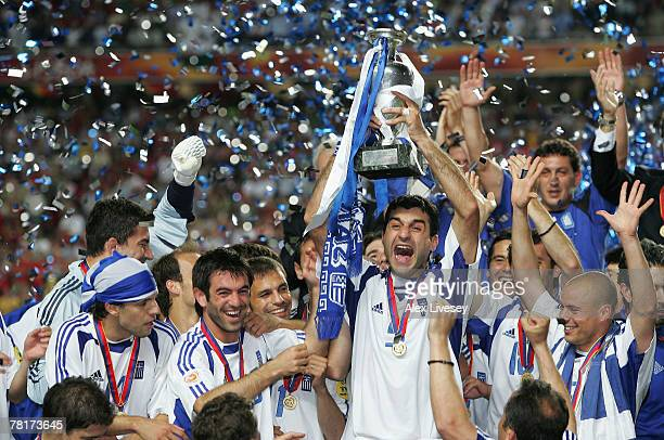 Traianos Dellas of Greece lifts the trophy during the UEFA Euro 2004 Final match between Portugal and Greece at the Luz Stadium on July 4 2004 in...