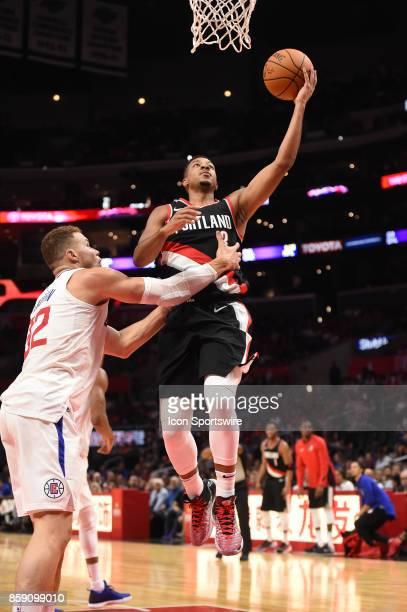 Trail Blazers CJ McCollum drives through LA Clippers Blake Griffin for a basket during an NBA preseason game between the Portland Trail Blazers and...