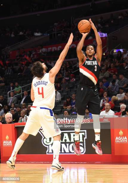 Trail Blazers CJ McCollum shoots over LA Clippers Milos Teodosic during an NBA preseason game between the Portland Trail Blazers and the Los Angeles...