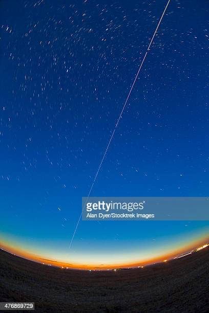 Trail of the International Space Station coming out of the western twilight.