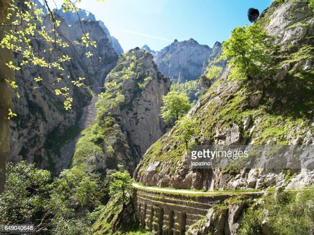 Trail on the edge of cliffs along the Route of the Cares in Asturias