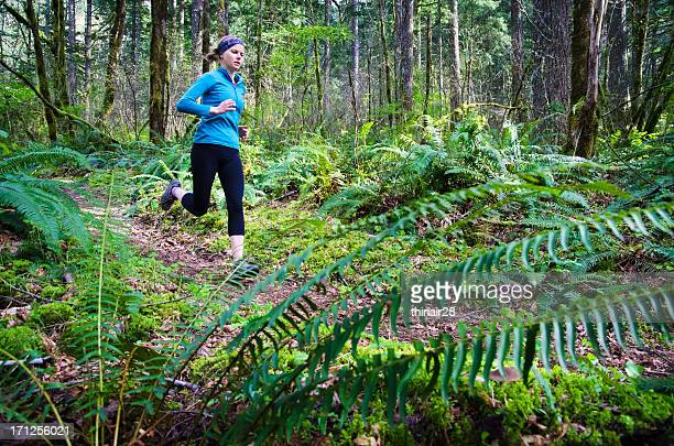 Trail runner in forest
