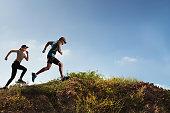 Trail Runner of men and women running on the mountain