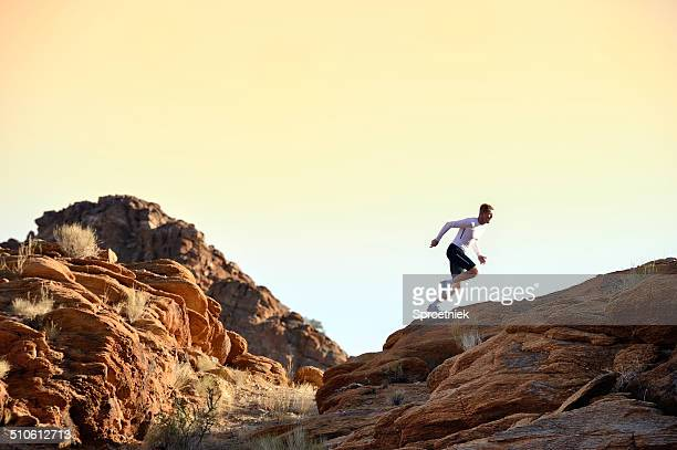Trail runner sprinting on horizon