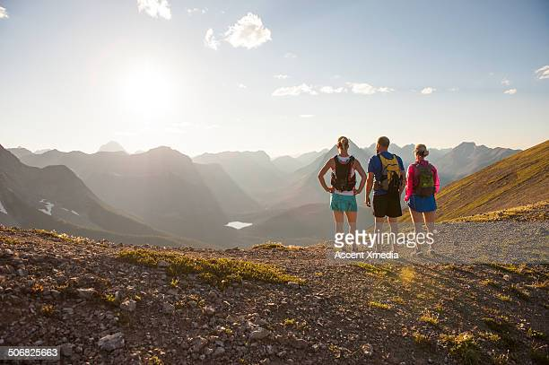 Trail runners relax for moment on mountain ridge