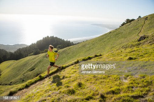 Trail running above the ocean. : Stock Photo