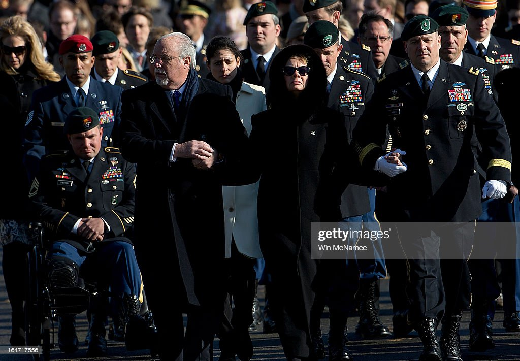 Trailed by family and friends, Helen Pedersen-Keiser (C) is accompanied by her husband Robert Keiser (L) and Brig. Gen. Christopher K. Haas (R), commander, U.S. Special Forces Command, during a burial service for her son, U.S. Army Capt. Andrew Pedersen-Keel at Arlington National Cemetery March 27, 2013 in Arlington, Virginia. Capt. Pedersen-Keel was killed on March 11, 2013 while serving in Wardak Province, Afghanistan from injuries sustained when attacked by small arms fire from a man in an Afghan police uniform, according to reports.