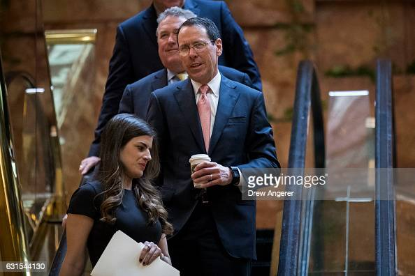 Trailed by Robert Quinn senior vice president at ATT ATT Chief Executive Officer Randall Stephenson takes an escaltor down to the lobby at Trump...