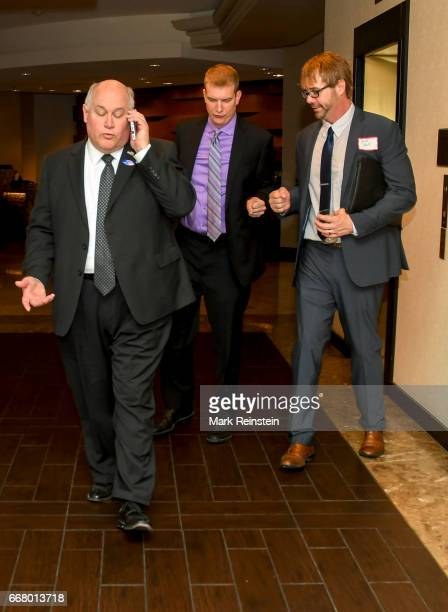 Trailed by two aides American politician and Kansas State Treasurer Ron Estes talks on his smartphone as he attends a celebration in honor of his...