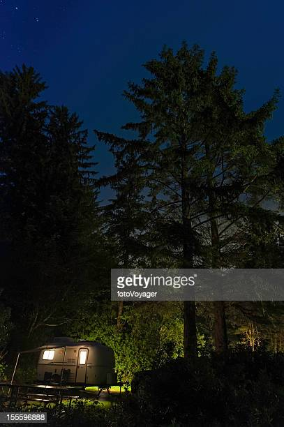 Trailer illuminated in star forest night Oregon