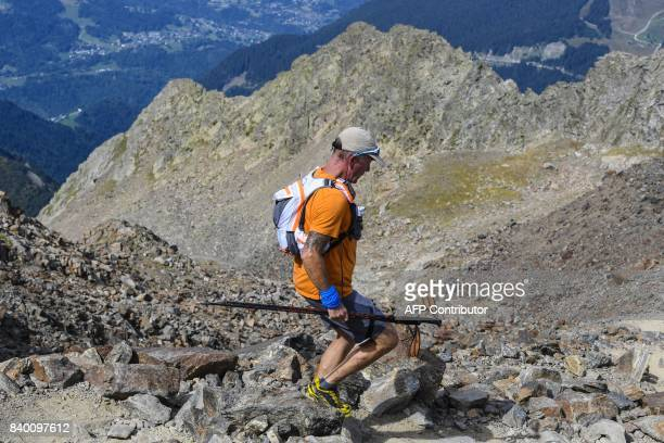 A trailer runs in the famous 'Couloir du Goûter' on the 'voie royale' route to climb atop the MontBlanc peak on August 27 2017 in the MontBlanc range...