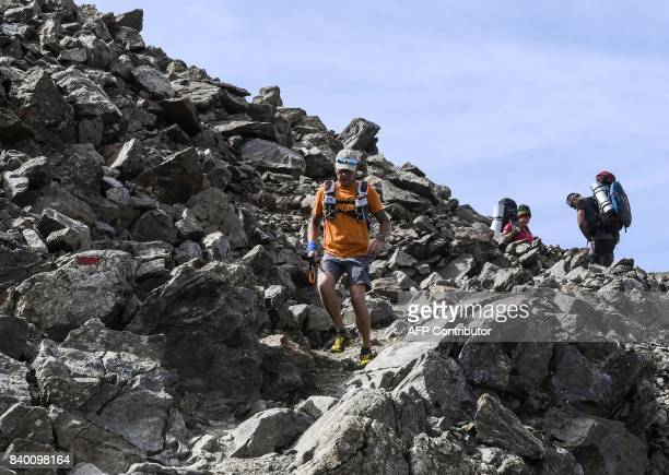 A trailer runs past climbers in the famous 'Couloir du Goûter' on the 'voie royale' route to climb atop the MontBlanc peak on August 27 2017 in the...