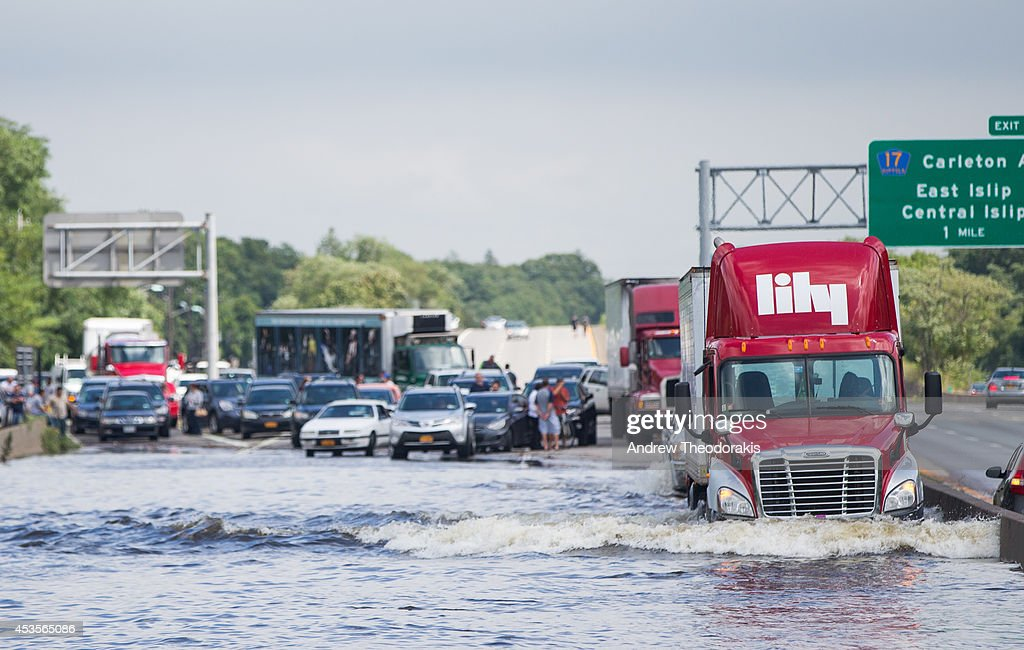 A trailer truck drives through flooded Sunrise Highway at Route 111 following heavy rains and flash flooding August 13, 2014 in Islip, New York. The south shore of Long Island along with the tri-state region saw record setting rain that caused roads to flood entrapping some motorists.