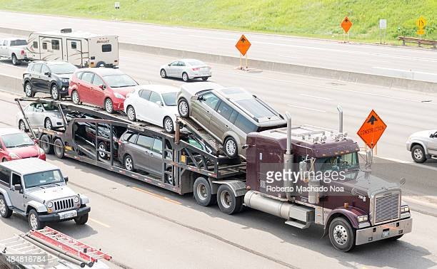 401 HIGHWAY TORONTO ONTARIO CANADA Trailer truck transporting cars between Canada and the United States through highway 401 Brandnew cars on a car...