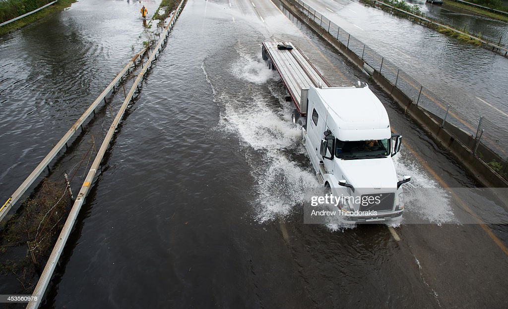A trailer truck traverses a flooded street at Sunrise Highway following heavy rains and flash flooding August 13, 2014 in Bayshore, New York. The south shore of Long Island along with the tri-state region saw record setting rain that caused roads to flood entrapping some motorists.