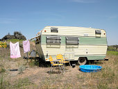 trailer with laundry, chairs wading pool