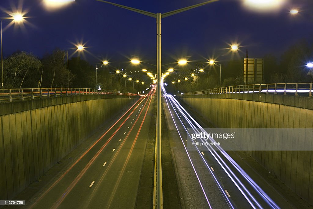 Trailing vehicle lights on tunnel road : Stock Photo