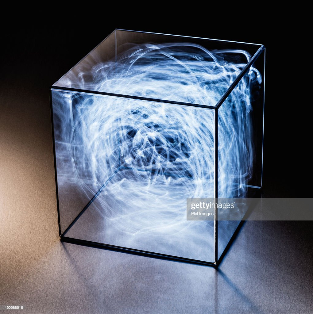 Trails of blue light in clear box