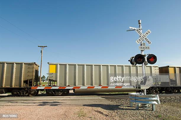 Train and railroad crossing