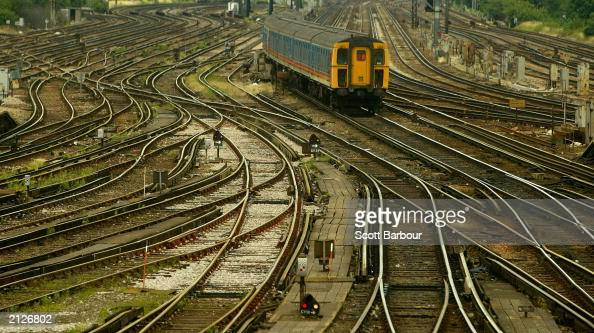 A train arrives at Clapham Junction station June 30 2003 in London England Network Rail has confirmed 2000 jobs will go over the next 3 years as part...