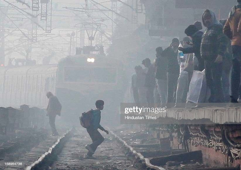 Train arrives at Hazrat Nizzamuddin railway station on January 4, 2013 in New Delhi, India. Delhi experienced the Coldest Morning Temperature of 2.7 Degree Celsius of this Winter Season. Dense fog has affected around 45 trains and 22 flights.