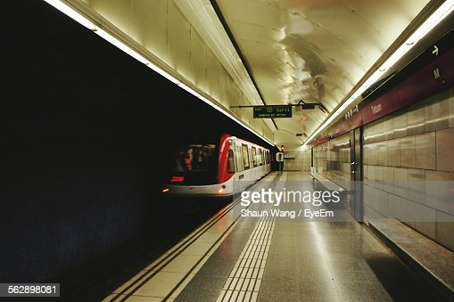 Train Arriving At Illuminated Subway Station