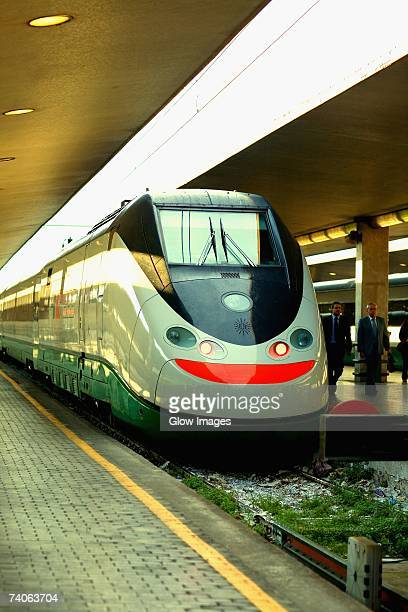 Train at a railroad station platform, Rome, Italy