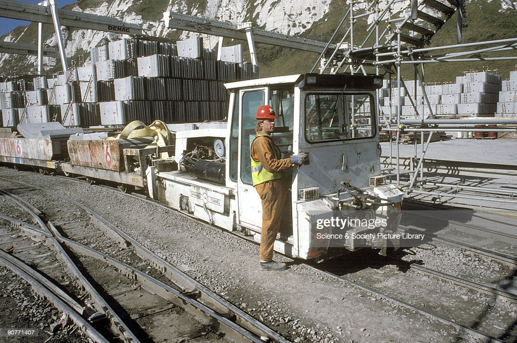 Train at the mouth of the Channel Tunnel at Shakespeare Cliff Dover by Chris Hogg 1993 This photograph was taken as the tunnel was being built During...