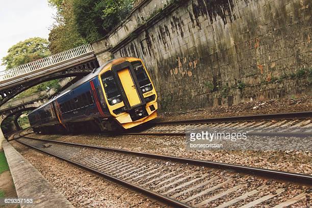 Train Below Bridge