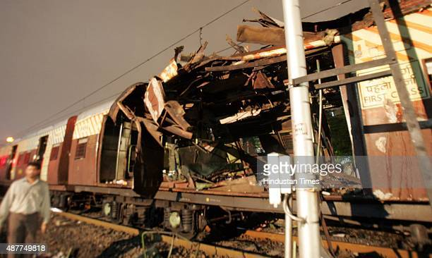 A train car destroyed by a bomb blast at Khar railway station on July 11 2006 in Mumbai India Seven explosions rocked Bombay's commuter rail network...