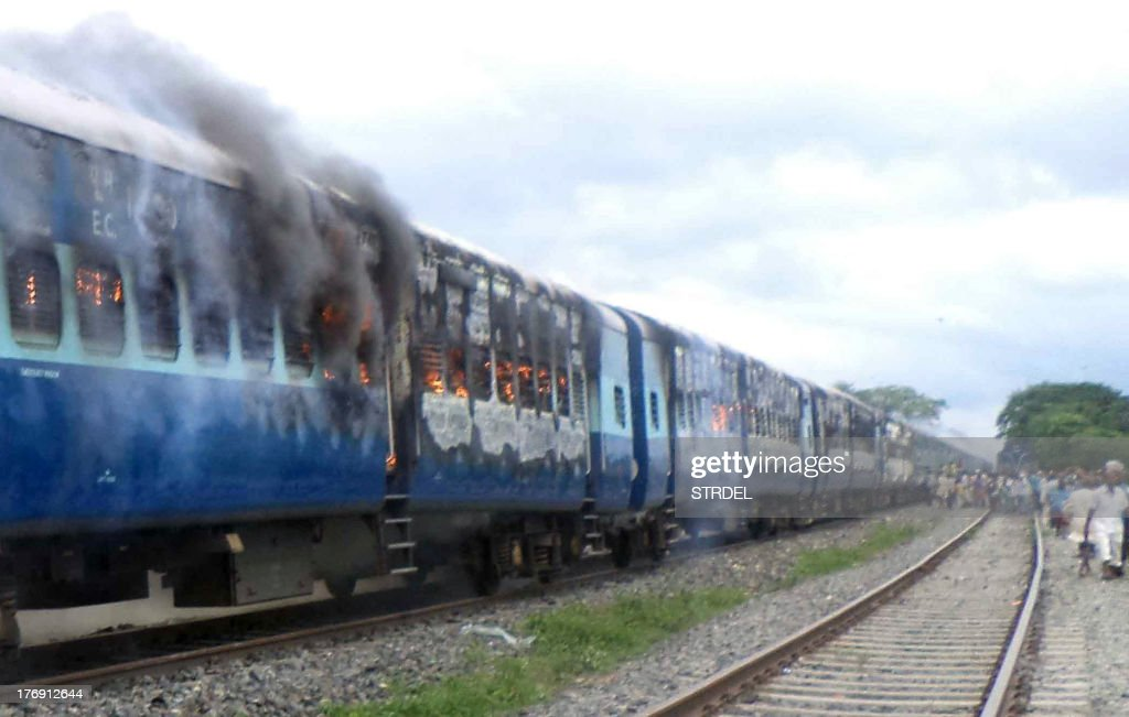 Train coaches of the Rajya Rani Express, set on fire by an angry mob, burns after the train ploughed into a crowd of Hindu pilgrims at the Dhamara Ghat railway station in Khagaria district, some 248 kilometres (154 miles) from Bihar state capital Patna, on August 19, 2013. An Indian express train ploughed into a crowd of Hindu pilgrims in the country's east on August 19, killing 37 and triggering a riot that left one of the drivers dead, an official said.