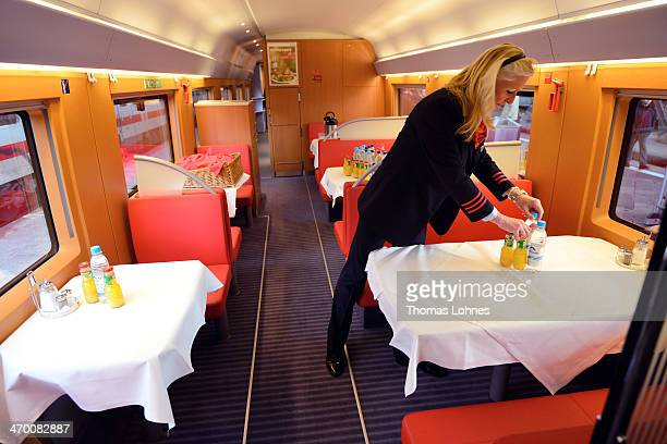 A train conductor arranges soft drinks at the on board restaurant of the latest generation of the ICE 3 Deutsche Bahn highspeed train version 407...