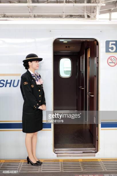 Train conductor near Shinkansen