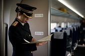 A train conductor stands aboard a highspeed train departing the Beijing West Railway Station in Beijing on December 22 2012 China showed off the...