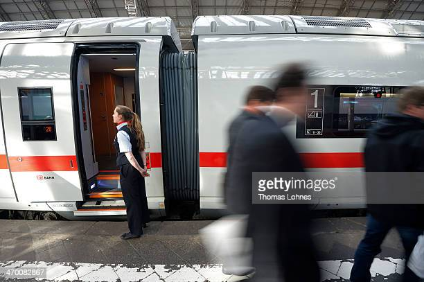 A train conductor stands next to a door of the latest generation of the ICE 3 Deutsche Bahn highspeed train version 407 during a media presentation...