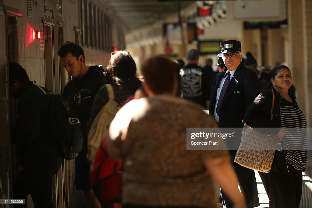A train conductor stands outside of a NJ Transit train as a strike looms on one of the nations most popular commuter lines on March 9 2016 in Newark...