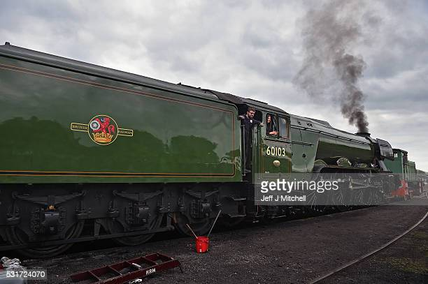 BO'NESS SCOTLAND MAY 16 Train crew work on the Flying Scotsman at Bo'ness and Kinneil Railway station on May 16 2016 in Bo'ness Scotland The Flying...