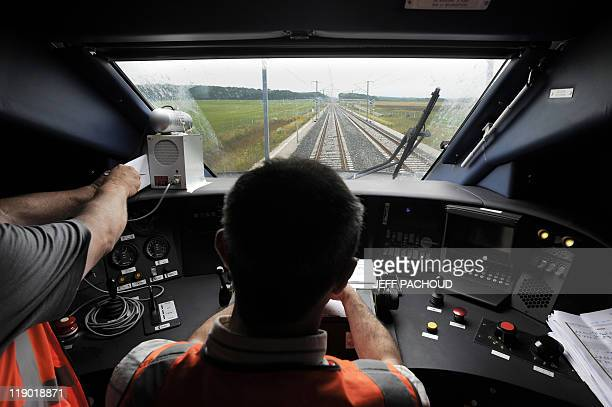 A train driver sits at the controls onboard the new LGV on June 29 near Auxon Dessus Burgundy central France The train which will operate on the...