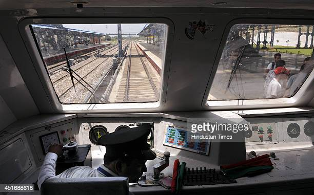 Train driver waits for a green signal at Katra Railway station after the inauguration ceremony at Katra railway station on July 4 2014 in Katra about...